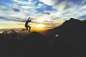 teen silhouette leaping at sunset unsplashdotcom