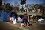 """Stacie McDonough, 51, poses for a portrait by her tent at a homeless motorhome and tent encampment near LAX airport in Los Angeles, California, United States, October 26, 2015. McDonough is an army veteran with a college degree who was recently made homeless. Los Angeles is grappling with a massive homelessness problem, as forecasted El Nino downpours threaten to add to the misery of thousands of people who sleep on the streets. Mayor Eric Garcetti has proposed spending $100 million to combat the problem in the sprawling metropolis but stopped short of declaring a state of emergency.  REUTERS/Lucy Nicholson PICTURE 2 OF 17 - SEARCH """"NICHOLSON MOTORHOME"""" FOR ALL IMAGES TPX IMAGES OF THE DAY"""