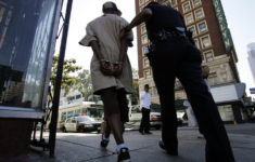 A Los Angles Police officer arrests a man for narcotics possession along Main Street, in LA's Downtown Historic District Friday June 2, 2006. Los Angeles boosters are in New York this week trying to sell downtown L.A. to investment firms and national developers. A major problem downtown is the homeless population.  (Photo by Spencer Weiner/Los Angeles Times via Getty Images)