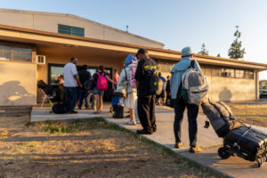 Homeless men and women line up outside the California National Guard Armory in Santa Ana on Thursday, July 12, 2018 to spend the night in the shelter. Approximately 200 homeless that have been sleeping at the armory during the summer 90-day extension will have find somewhere else to sleep after the extension ends on Saturday, July, 14.  (Photo by Leonard Ortiz, Orange County Register/SCNG)
